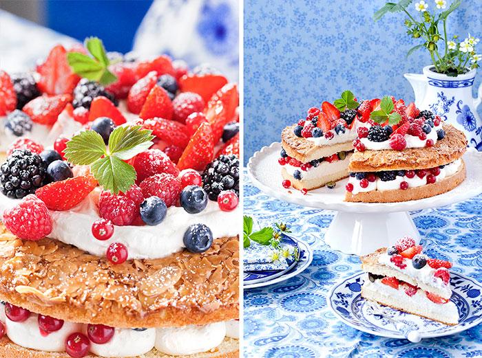 Doppelter Kuchen mit Sahne und frischen Beeren in mehreren Schichten