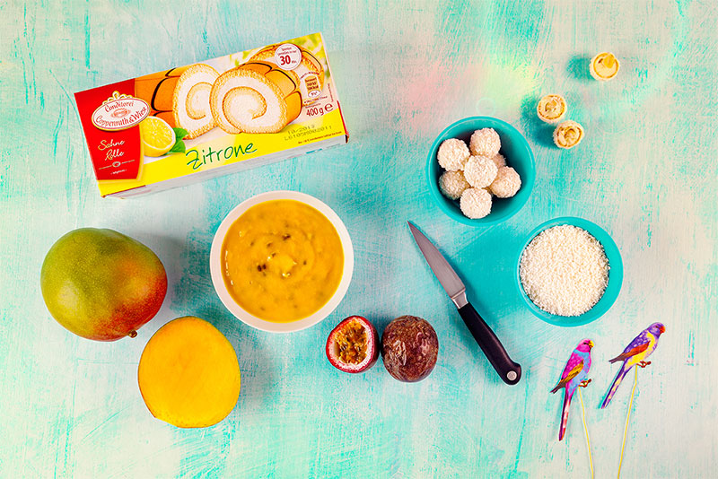Zutaten für fruchtige Sahnerolle mit Maracuja, Mango und Kokos