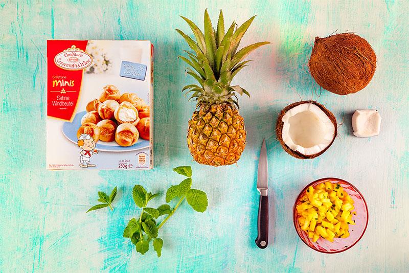 Zutaten für mit Ananas gefüllte Kokosnuss plus Windbeutel